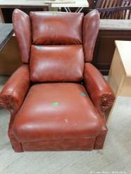 Description 325 Red/Brown Leather Rocker Chair