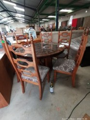 Description A stunning retro solid wood hand carved dining room table with glass top cover (140 x 140 x 77 cm)  and 6 x high back wood framed and material cushioned seating chair (50 x 50 x 100 cm each. This bid will be used as your proxy bid on our live auction - Online bidders will be notified by 6 Pm by Auction day. AP Score 10/10. This is a live and online auction.