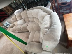 Description A beige material corner comfy lounge suite (370 x 190 x 110 cm)  needs a good clean.  This bid will be used as your proxy bid on our live auction - Online bidders will be notified by 6 Pm by Auction day. AP Score 8/10. This is a live and online auction.