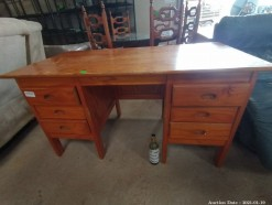 Description A varnished pine office desk with side drawers and cupboards on each side (144 x 74 x 74 cm)  This bid will be used as your proxy bid on our live auction - Online bidders will be notified by 6 Pm by Auction day. AP Score 10/10. This is a live and online auction.