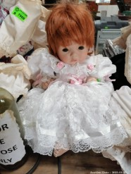 Description An antique white laced christening baby porcelain doll (30 x 30 x 30 cm)  This bid will be used as your proxy bid on our live auction - Online bidders will be notified by 6 Pm by Auction day. AP Score 10/10. This is a live and online auction.