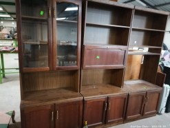 Description Of Yesteryear three piece wall unit with shelving, bottom & top double door cupboards and liquor cabinets (240 x 46 x 200 cm)  This bid will be used as your proxy bid on our live auction - Online bidders will be notified by 6 Pm by Auction day. AP Score 10/10. This is a live and online auction.
